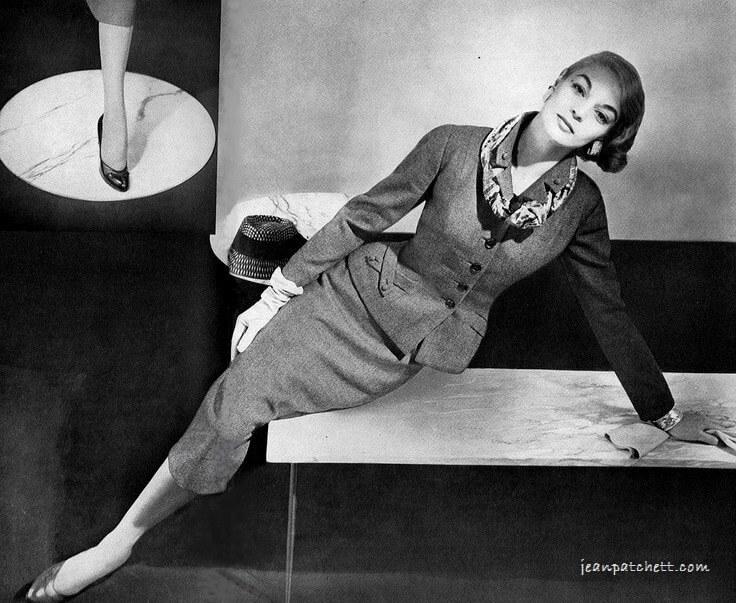 AAA. Jean Patchett in elegant suit by Handmacher Vogue US August 15 1954